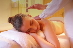Patient receiving massage therapy in a relaxing environment